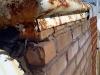 Solin à réparer car l'eau endommage le parement de briques