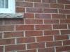 Lézarde dans le parement de briques